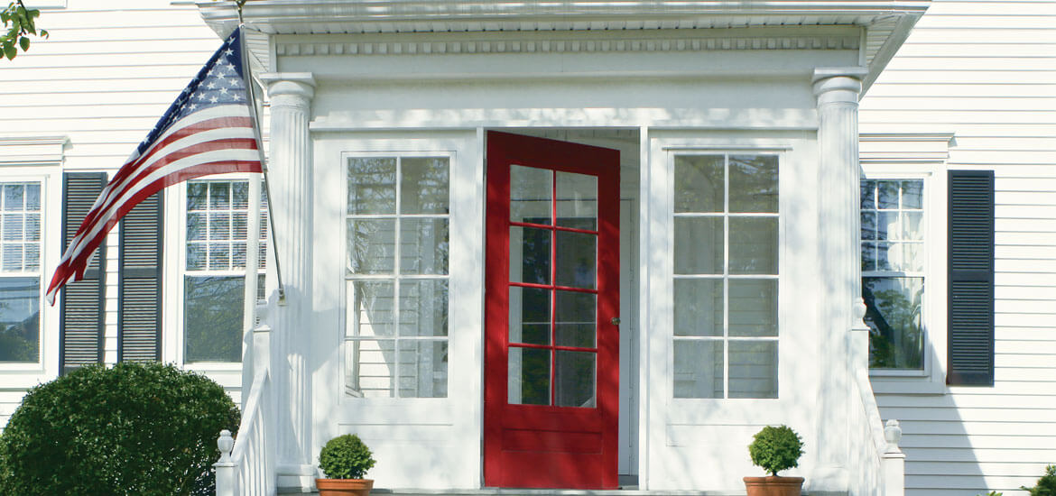 House with red door and American flag